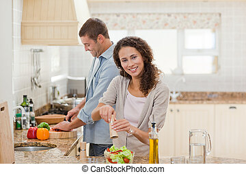 Handsome man cooking with his girlfriend