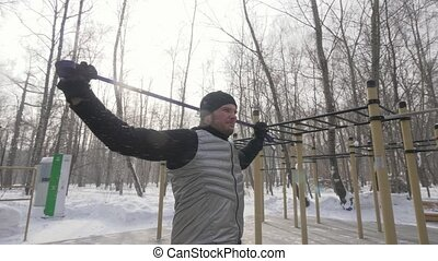 Handsome man doing workout exercise with fitness expander on...