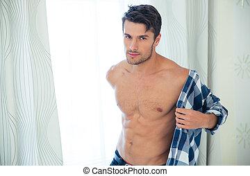 Handsome man dressing shirt - Portrait of a handsome man...