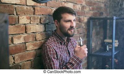Handsome man Exhaling smoke from a vaporizer shot - Man...