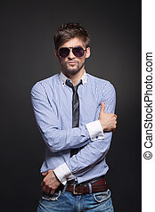 Handsome man - Fashion handsome man posing over black...