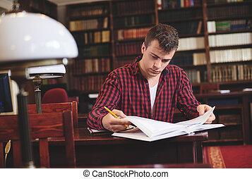 Handsome man focused on reading