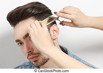 Handsome man having haircut