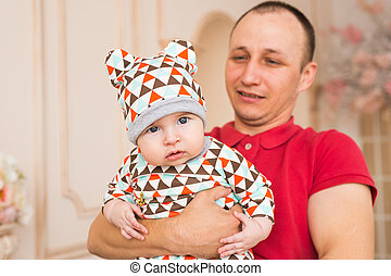 man holding a baby son