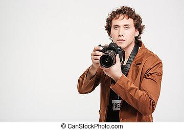 Handsome man holding camera