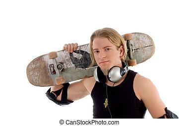 handsome man holding skateboard