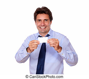 Handsome man holding up his blank business card