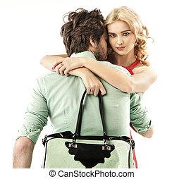 Handsome man hugging a sensual woman