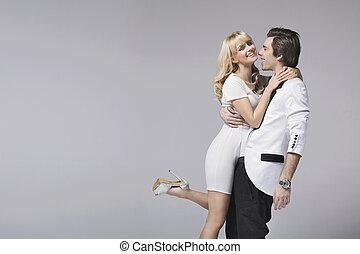 Handsome man hugging his adorable girlfriend