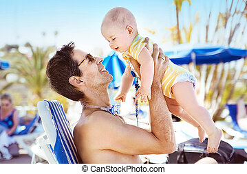 Handsome man hugging his beloved son