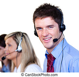 Handsome man in a call center