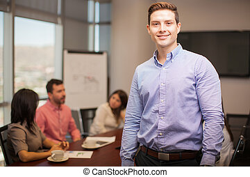 Handsome man in a meeting room - Portrait of a young ...