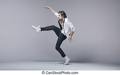 Handsome man in acrobatic pose