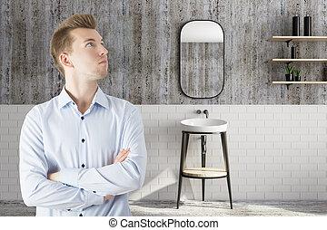 Handsome man in bathroom