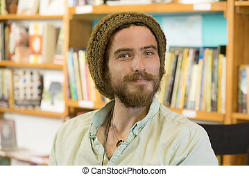 Handsome Man in Book Store or Library