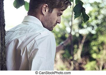 Handsome man in garden