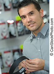 handsome man in hardware store