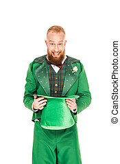 handsome man in leprechaun costume holding green hat, isolated on white