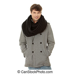 Handsome man in scarf and coat