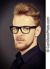 spectacles - Handsome man in spectacles over grey...