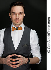 man in suit with bow-tie - handsome man in suit with bow-tie...
