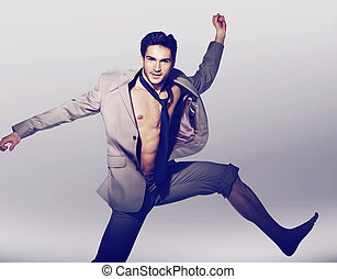 Handsome man in victorious jump