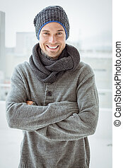 Handsome man in warm clothing smiling at camera on a chilly...