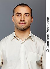 Handsome man in white shirt isolated on grey background
