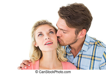 Handsome man kissing girlfriend on cheek