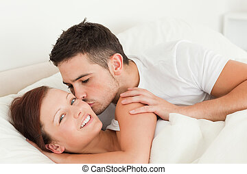 Handsome Man kissing his wife on the cheek