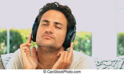 Handsome man listening to music