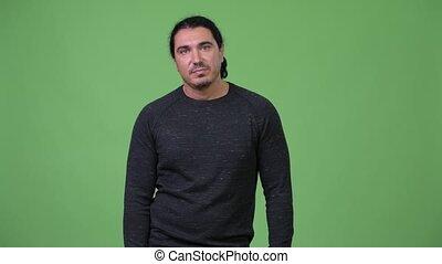 Handsome man looking bored - Studio shot of handsome man...