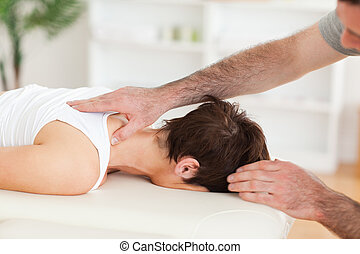 Handsome Man massaging a woman's neck