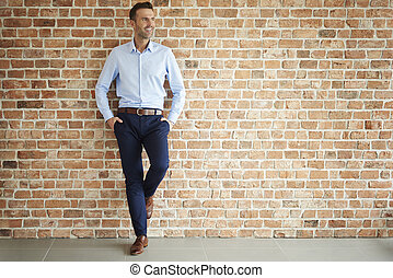 Handsome man on brick wall
