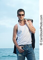 Handsome man on the beach