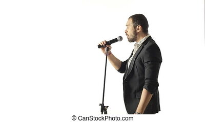 Handsome man performs a musical composition in the studio on a white background