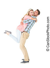 Handsome man picking up and hugging his girlfriend on white ...