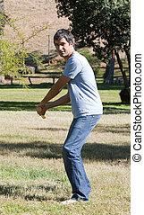 Handsome man playing baseball