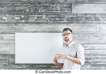 Handsome man pointing at whiteboard