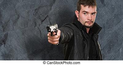 handsome man pointing with gun