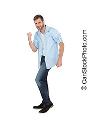 Handsome man posing with clenched fist