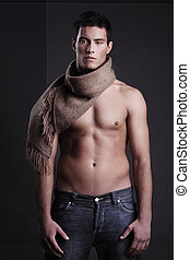 Handsome man posing with scarf