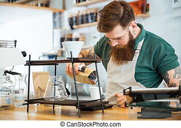 Handsome man preparing coffee