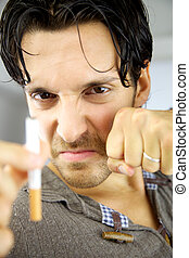 Handsome man ready to stop smoking