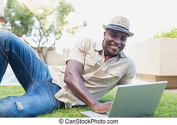 Handsome man relaxing in his garden