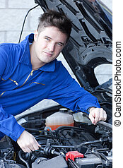 Handsome man repairing a car in his