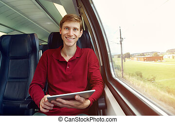 handsome man riding on a train