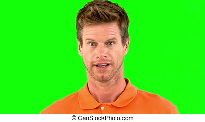 Handsome man saying yes with his head on green screen in...