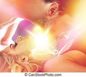 Handsome man seducing his sleepy lover