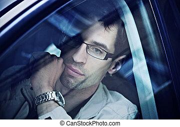 Handsome man sitting in a car
